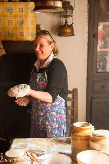 Frances showing off Soda Bread made by hand at Molly Gallivan's