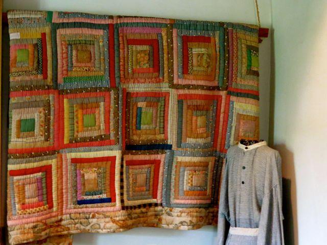 Handmade quilt and homespun clothing