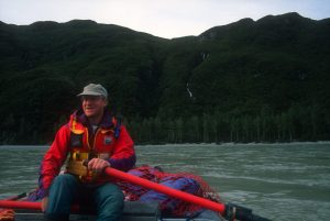 Grant on the oars on the mighty Alsek River.