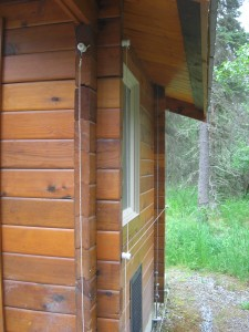 An outhouse outfitted with electric 'fencing' (or wires) to deter bears at Brooks Falls in Katmai National Park, Alaska.