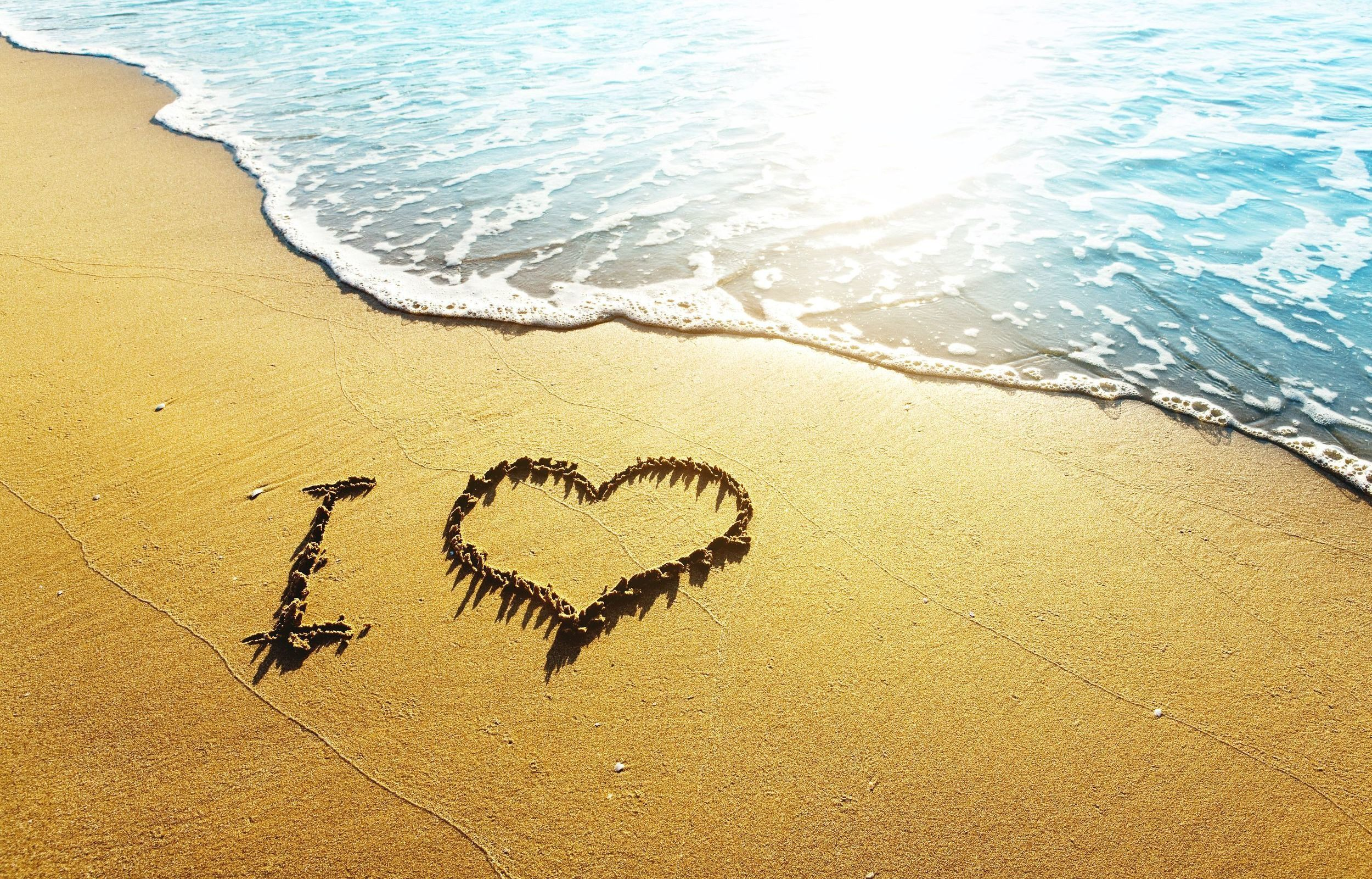 "Love Beach: ""I heart"" in the sand at the surf"