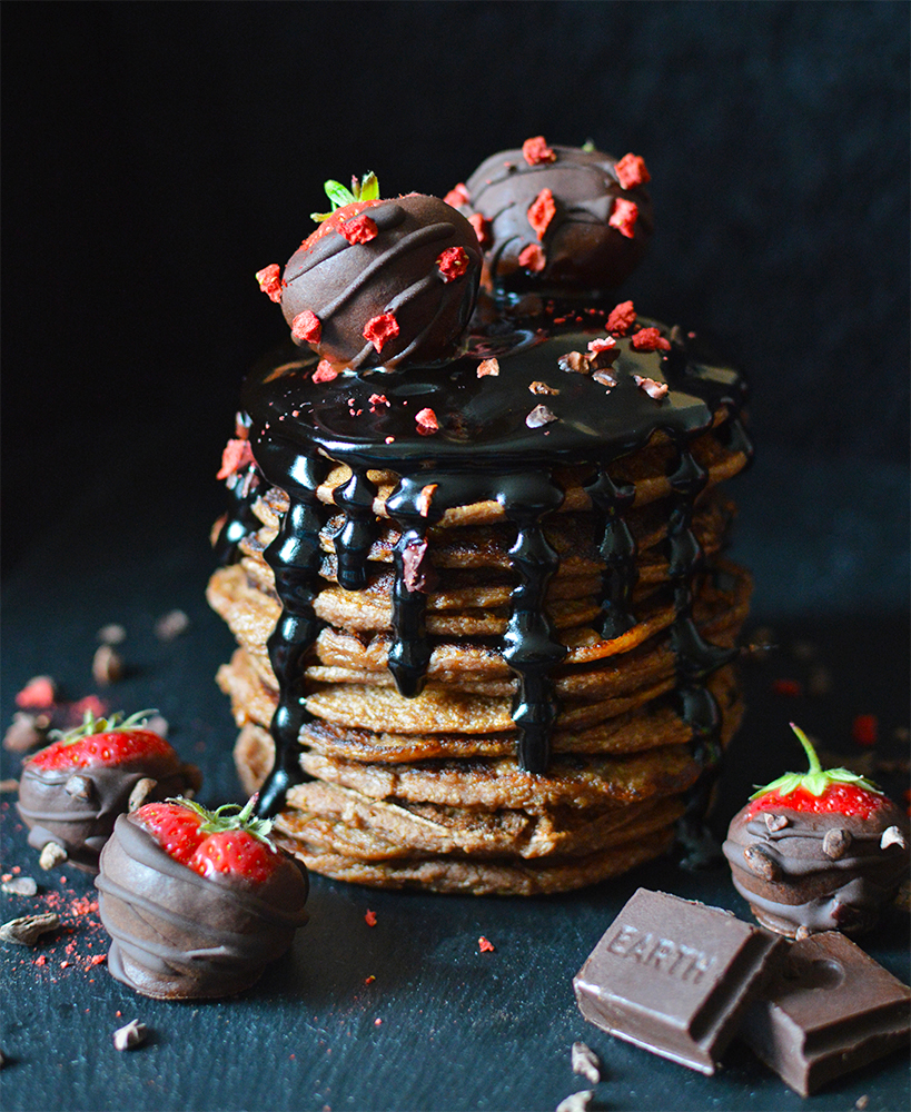 Vegan chocolate chip pancakes, served with raw carob fudge sauce and raw chocolate covered strawberries.