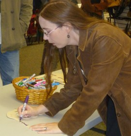 Jennifer Barnes signs the mask