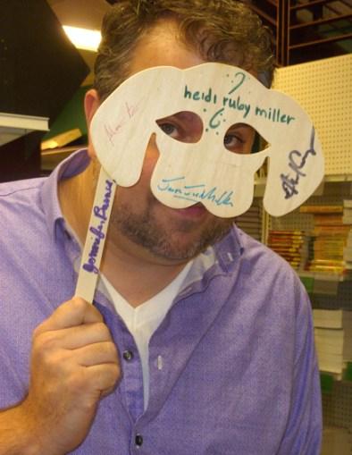 Jason models the mask