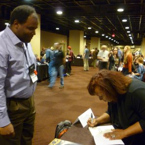 K. Ceres Wright signing for a fan