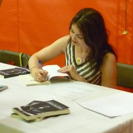 Heidi signing
