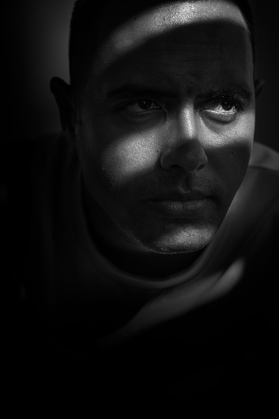 Portrait of Eremasi using light filtering through louvre blades