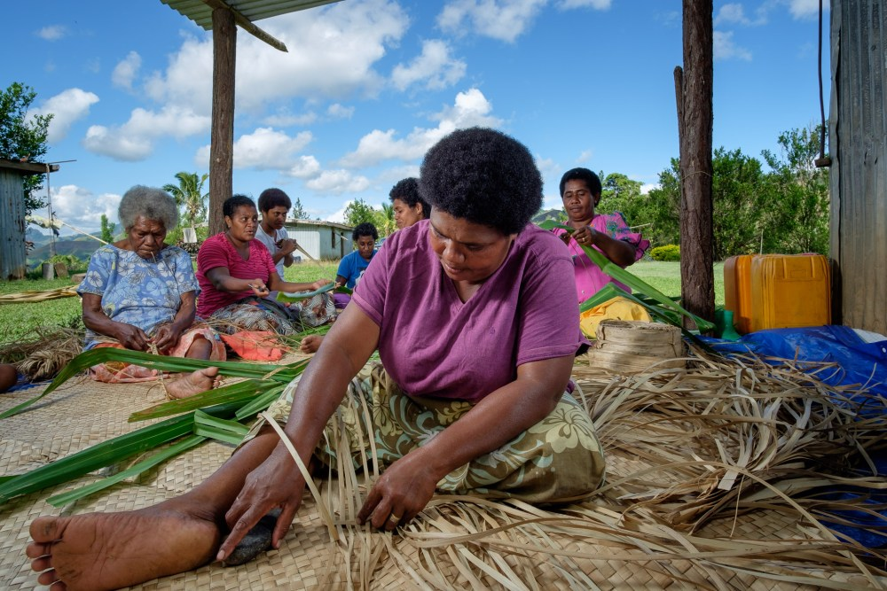 The women of Rara village weaving mats for supply to markets organised by Rise Beyond the Reef
