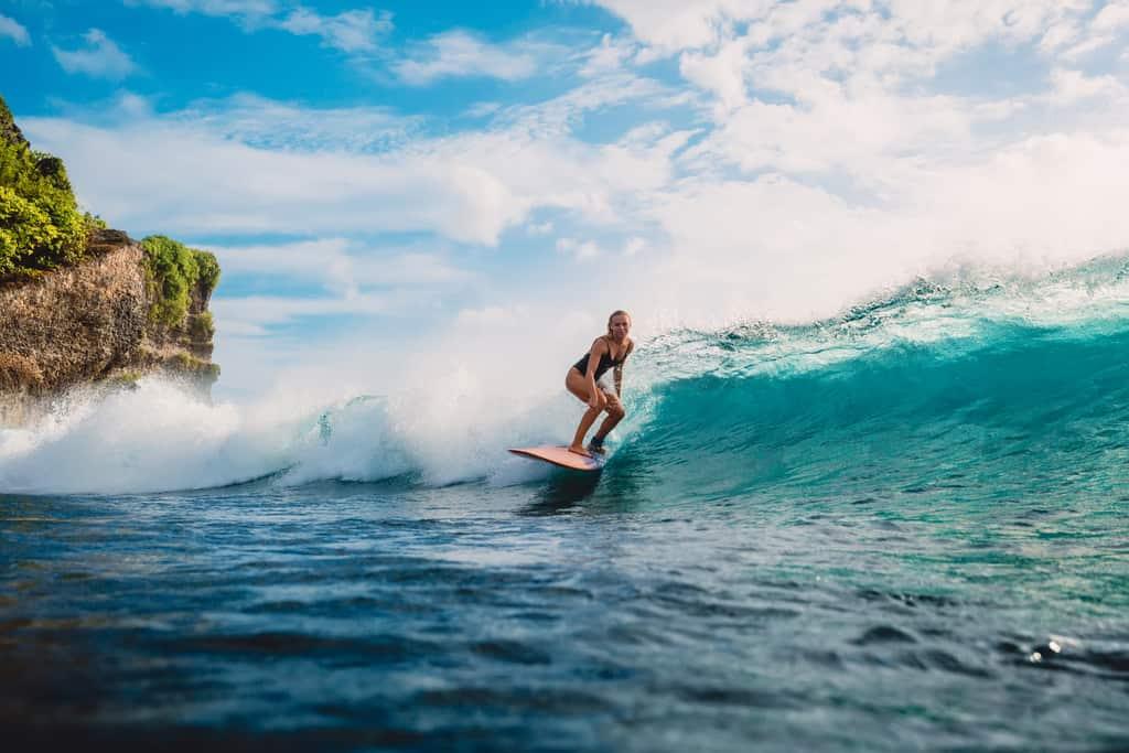 woman surfing in Bali