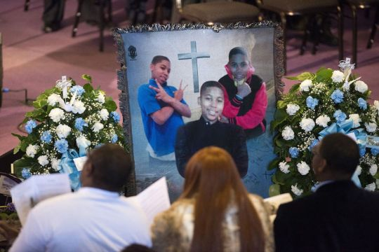 Family and friends sit and listen to kinds words being spoke during a memorial set up for Tamir Rice during the memorial ceremony for Tamir Rice, at the Mt. Sinai Baptist CHurch in Cleveland on Wednesday, December 3, 2014. Tamir was fatally shot by a police officer in Cleveland last week.