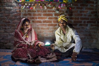 Holding a solar-powered lamp, Soni Suresh, 20, and Suresh Kashyap, 22, celebrate their marriage ceremony in Uttar Pradesh, where 20 million households lack electricity. PHOTO: Nat Geo