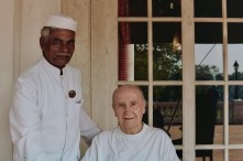 """An employee of the Madras Club, with """"master"""" John Davis, who has been going to the club since he was 20 years old."""