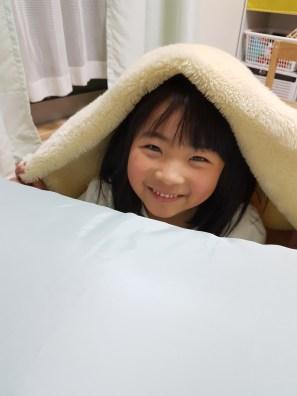 Ruka playing under the futon