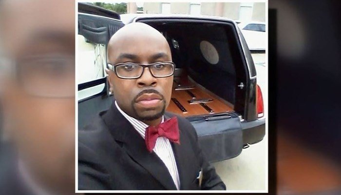 A woman took a look at the funeral director's Facebook page and found numerous photos of him with caskets and hearses. (Source: Facebook/KTRK/CNN)