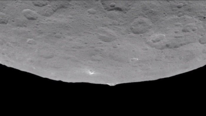 Cameras on the tractor-trailer-size spacecraft captured a pyramid-shaped structure rising three miles above Ceres' cratered surface. NASA scientists are calling it 'intriguing.' (Source: NASA/CNN)