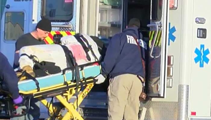 A person was being put into an ambulance after a shooting that left multiple people dead in Kansas. (Source: KSNW/CNN)