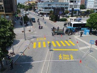 salihlide pedestrian safety in the foreground