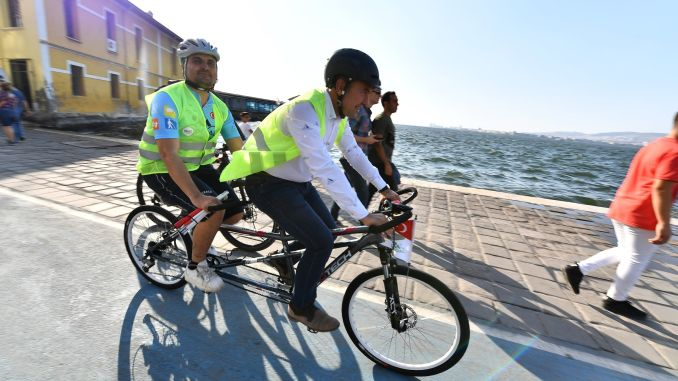 President Soyer pedals with visually impaired individuals