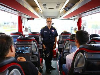 fire and accident warning to passengers on the bus from the marine fire department