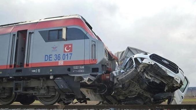 train crashed into the van trying to break the barriers in the opium