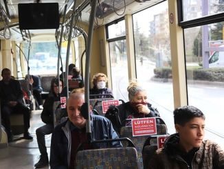 Eskisehir residents are warned with social distance visuals in tolu transportation