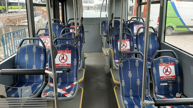 Does not sit two people side by side on the transportation buses
