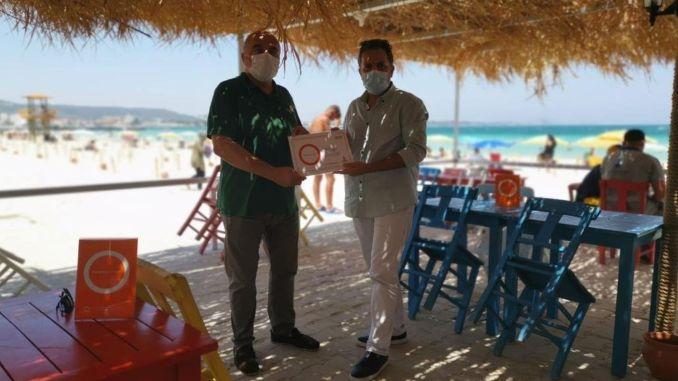 cesme ilica beach blue flag and orange circle certificate
