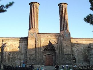 where is the double minaret madrasah, historical and architectural features