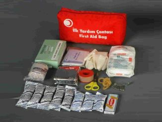 Is it mandatory to have a first aid kit in the vehicle? What should be in the first aid kit?