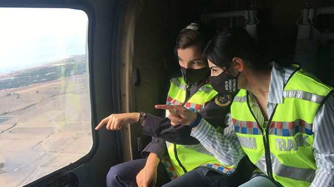 women officers control the traffic from the air