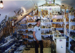 Shopkeeper in his gift shop
