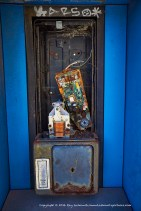 Pay phone in blue.