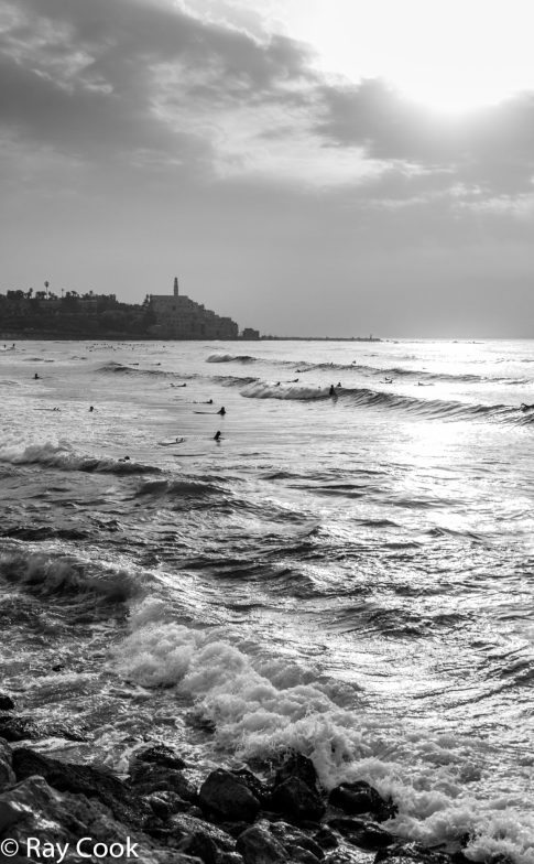 Surfing at sunset, Jaffa, Israel