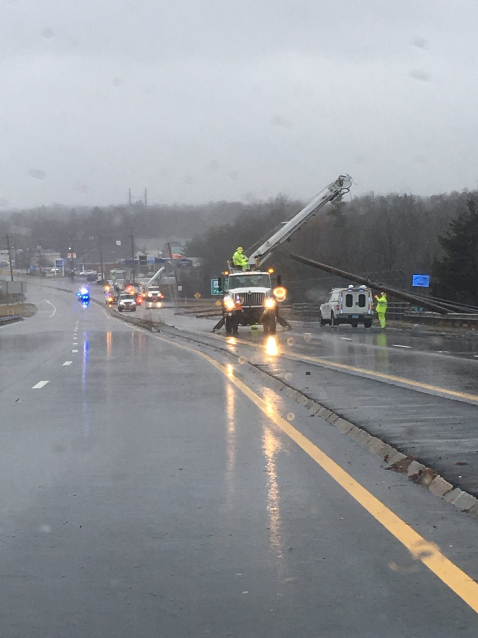 Taunton Municipal Lighting Plant is working on Route 44 to remove several downed telephone poles with live wires. (Courtesy Photo Raynham Police Department)