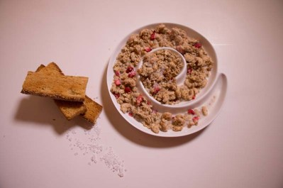 crunchy oats and raspberry with milk and biscuits