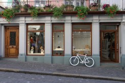 White bicycle infront of a shop in ZUrich Switzerland