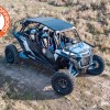 Polaris RZR XP Turbo S 4 seater on the trail with attached metal roof and glass windshield for sale