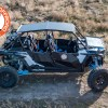Dirt riding with third party front folding glass windshield and hardcore aluminum roof UTV accessories