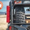 Polaris General Spare Tire Mount Shown on rack with rotopax and spare tire