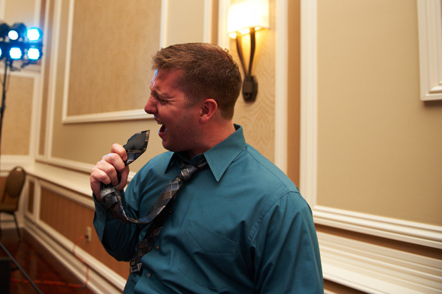 guest using his necktie as a microphone