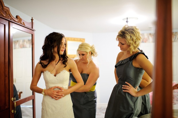 Bride with the bridesmaids getting ready at the Wild Rose Inn in Okoboji, Iowa