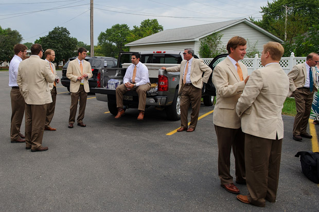 Groom and groomsmen waiting in the church parking lot