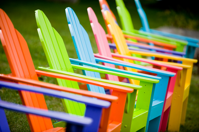 Colourful chairs on the beach