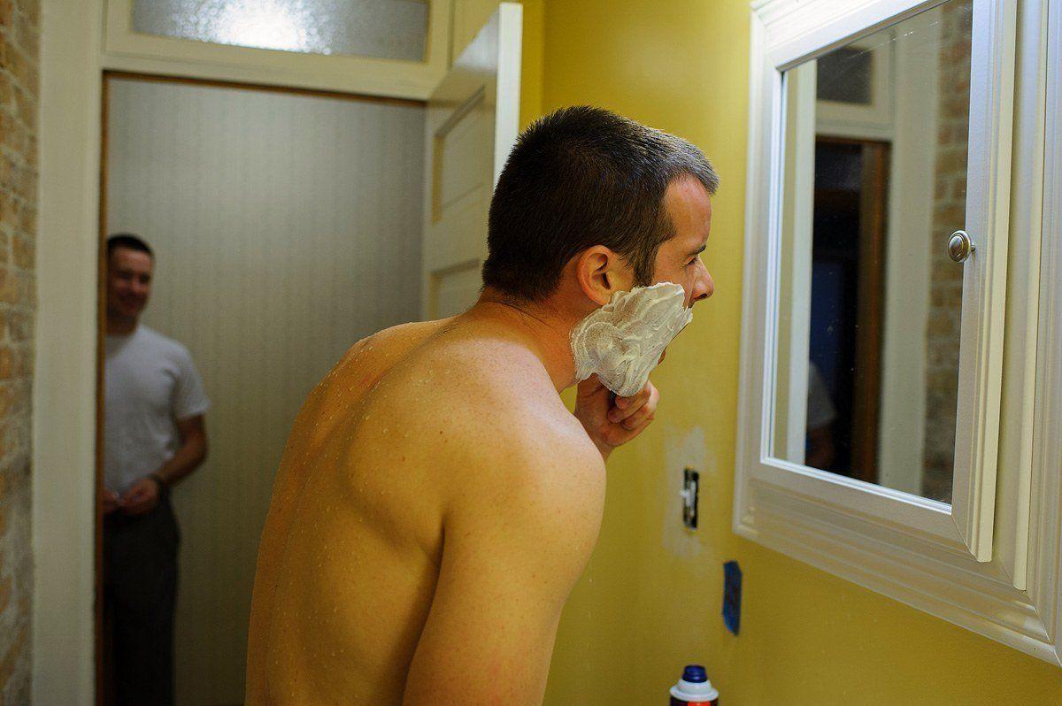 groom shaving before the ceremony