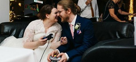 contact image bride and groom play videogames