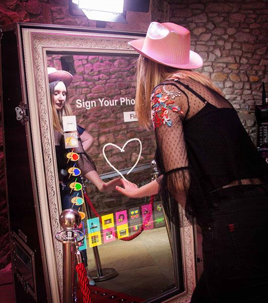 Woman using Magic Mirror Hirer