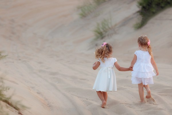 kids walking on sand rci plus topsail