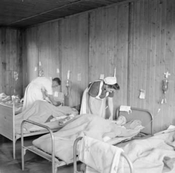 Scene in the blood transfusion ward at Sandbostel Comcentration Camp, copyright of the IWM