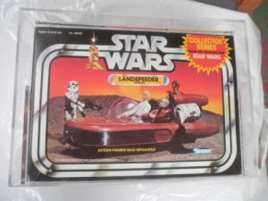 "Vintage Star Wars Landspeeder vehicle, after being ""graded"" and put in a clear box."