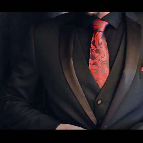 Formal elegant paisley tie in black and red color